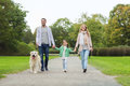 Happy family with labrador retriever dog in park Royalty Free Stock Photo