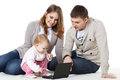 Happy family with laptop. Stock Photo