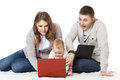 Happy family with laptop. Stock Image