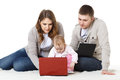 Happy family with laptop. Royalty Free Stock Images