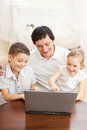 Happy family with laptop father children play in the computer Royalty Free Stock Photography