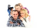 Happy family laying floor white background Stock Image