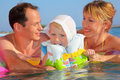 Happy family with little girl bathing in pool Stock Photography