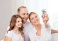 Happy family with little girl making self portrait child photography and home concept digital camera Royalty Free Stock Photos