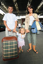 Happy family with little girl at railway station Royalty Free Stock Photo