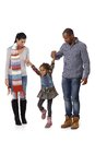 Happy family with little girl walking interracial jumping having fun Royalty Free Stock Images