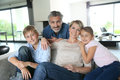 Happy family in the living room contemporary house Royalty Free Stock Photo