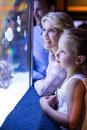 Happy family looking at starfish in a tank Royalty Free Stock Photo