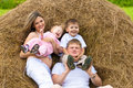 Happy family lying on haystack in summer Royalty Free Stock Photography