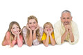 Happy family lying and smiling on white background Royalty Free Stock Images