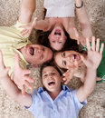 Happy family lying with their heads close together Royalty Free Stock Photography