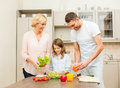 Happy family making dinner in kitchen food hapiness and people concept Royalty Free Stock Photo