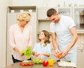 Happy family making dinner in kitchen food hapiness and people concept Royalty Free Stock Image