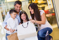 Happy family mall looking inside shopping bag Stock Photography