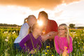 Happy family on meadow at sunset Royalty Free Stock Image