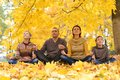 Happy family meditate portrait of in autumn park Stock Images