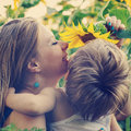 Happy family mom and son in sunflowers Royalty Free Stock Image