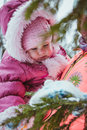 Happy family mother and baby girl daughter in winter outdoors Royalty Free Stock Photo