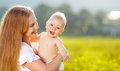 Happy family mother and baby hugging nature in summer Royalty Free Stock Photo