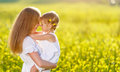 Happy family mother and child daughter embrace  on nature in sum Royalty Free Stock Photo