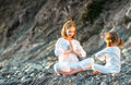 Happy family mother and child doing yoga, meditate in lotus posi Royalty Free Stock Photo