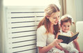 Happy family mother child little girl reading  book Royalty Free Stock Photo