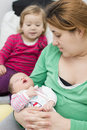 Happy family mother and child with newborn baby Stock Images