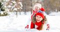 Happy family mother and child playing on winter walk Royalty Free Stock Photo