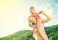 Happy family mother and daughter baby girl playing on nature outdoors Royalty Free Stock Photography