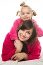 Happy family mother and daughter in dressing gowns Royalty Free Stock Photography