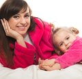 Happy family mother and daughter in dressing gowns Stock Photography
