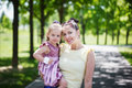 Happy family. Mother and the daughter look at camera, smile, emb Royalty Free Stock Photo