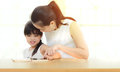 stock image of  Happy family mother and daughter read a book at home
