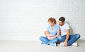 Happy family mother, father of a newborn baby on floor near blan Royalty Free Stock Photo