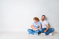 happy family mother, father of a newborn baby on floor near blank wall Royalty Free Stock Photo