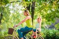 Happy family. mother and son riding a bicycle together outdoors in a city park Royalty Free Stock Photo