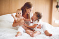 Happy family mother and two children, son and daughter in bed Royalty Free Stock Photo