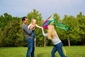 Happy family in nature. Dad, mom and daughter child flying a kit Royalty Free Stock Photo