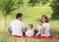 Happy family in nature relaxing together green Royalty Free Stock Photo