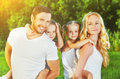 Happy family on nature of summer, mother, father and children tw Royalty Free Stock Photo