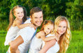 happy family on nature of summer, mother, father and children twin sisters Royalty Free Stock Photo