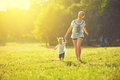 Happy family on nature walks in the summer mother and child run field Royalty Free Stock Images