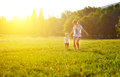 Happy family on nature walks in the summer mother and child run field Stock Image