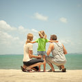 Happy family near the beach at day time Stock Images