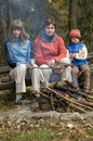 Happy family  near campfire Royalty Free Stock Photos