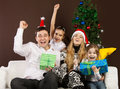 Happy family near the Christmas tree Royalty Free Stock Photo