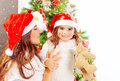 Happy family near christmas tree beautifully decorated young mother with cute daughter wearing red santa hat copy space winter Stock Photos