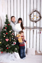 Happy family near the christmas tree new year holiday concept Stock Photography