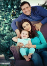 Happy family near the christmas tree with present Stock Images