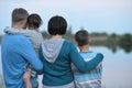 Happy family near lake Royalty Free Stock Photo